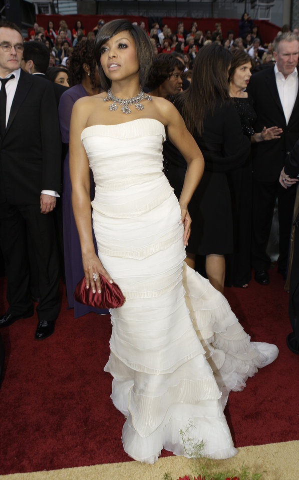 Photo - ** LINDA MILLER'S COMMENTARY:  Strapless was the dress of choice and this looked like a delicious confectionary. She looked good in white. Love the necklace. Sometimes big is better.    ** Taraji P. Henson arrives for the 81st Academy Awards Sunday, Feb. 22, 2009, in the Hollywood section of Los Angeles. (AP Photo/Amy Sancetta) ORG XMIT: CARS140