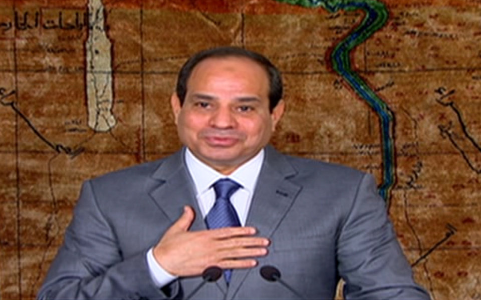 """Photo - In this image made from video broadcast on Egypt's State Television, Egyptian President Abdel-Fattah el-Sissi speaks in a nationally televised broadcast in Cairo, Egypt, Monday, July 7, 2014. El-Sissi has defended his recent decisions to partially lift subsidies on fuel, calling them a necessary """"bitter pill"""" and he couldn't delay such decisions even if it cost him support because """"the dangers are great"""" for Egypt's economy. The decision shocked many in the country where nearly 50 percent live in poverty. (AP Photo/Egypt's State Television)"""