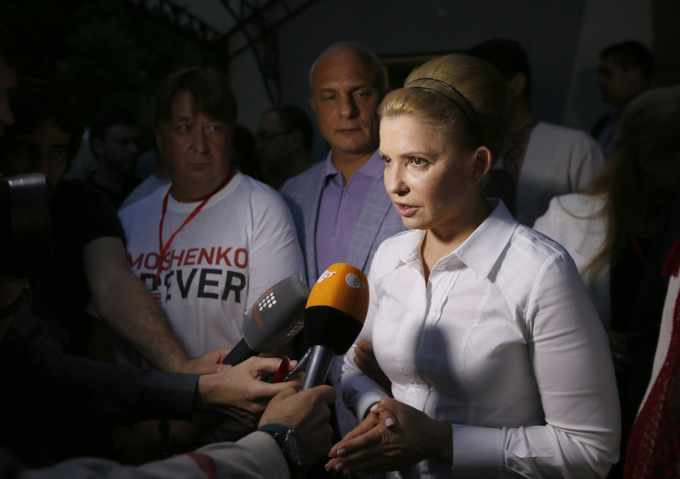 Photo - Ukraine presidential candidate Yulia Tymoshenko speaks to press in Kiev, Ukraine, Sunday, May 25, 2014. An exit poll showed that billionaire candy-maker Petro Poroshenko won Ukraine's presidential election outright Sunday in the first round — a vote that authorities hoped would unify the fractured nation. (AP Photo/Olexander Prokopenko, Pool)