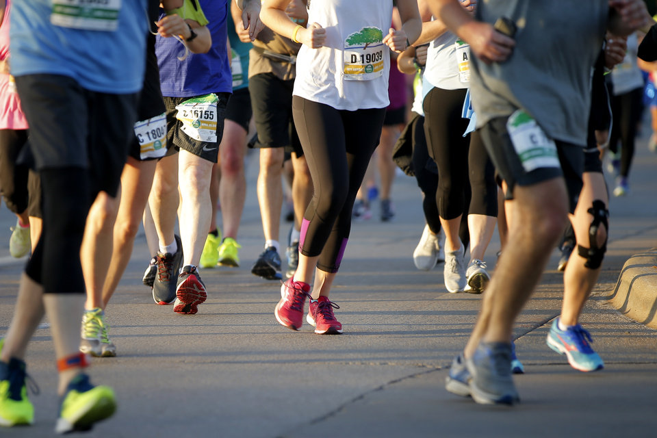 Photo - Runners make their way south on Lincoln Blvd. during the Oklahoma City Memorial Marathon in Oklahoma City, Sunday, April 29, 2018. Photo by Bryan Terry, The Oklahoman