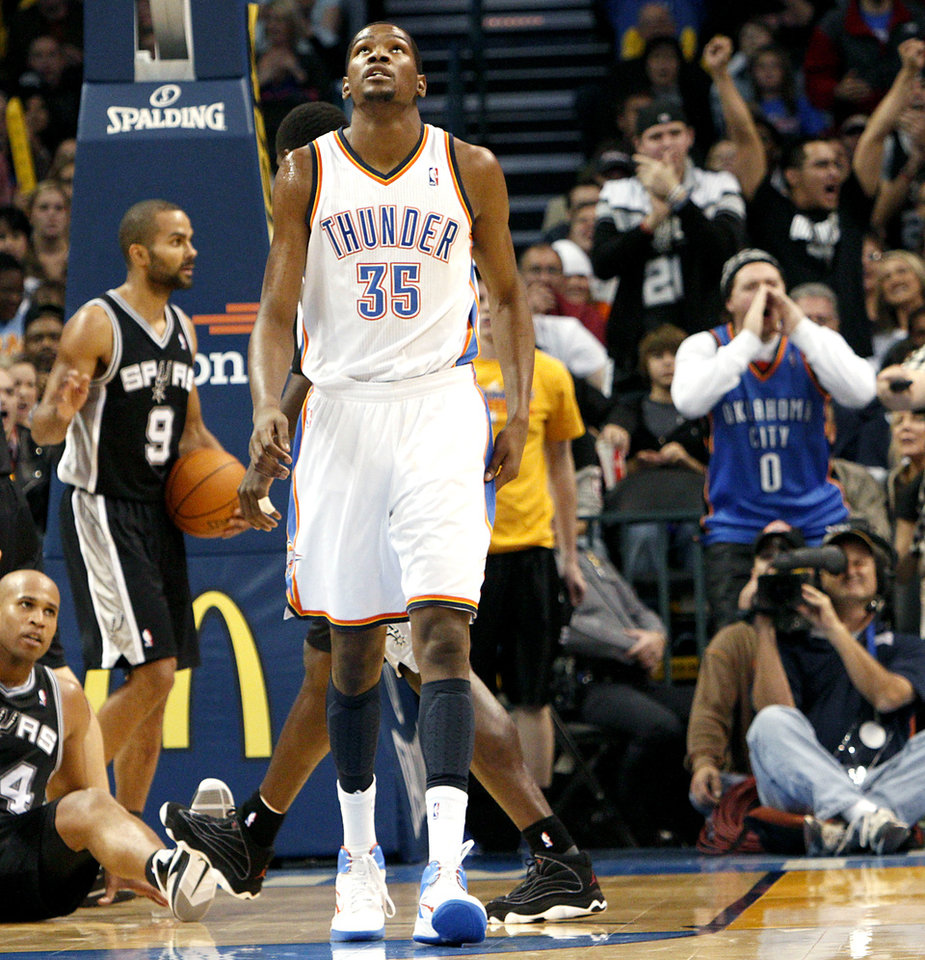Photo - Oklahoma City's  Kevin Durant reacts to a foul called on him during the second half of their game against San Antonio during their NBA basketball game in downtown Oklahoma City  on Sunday, Nov. 14, 2010. The Thunder lost to the Spurs. Photo by John Clanton, The Oklahoman
