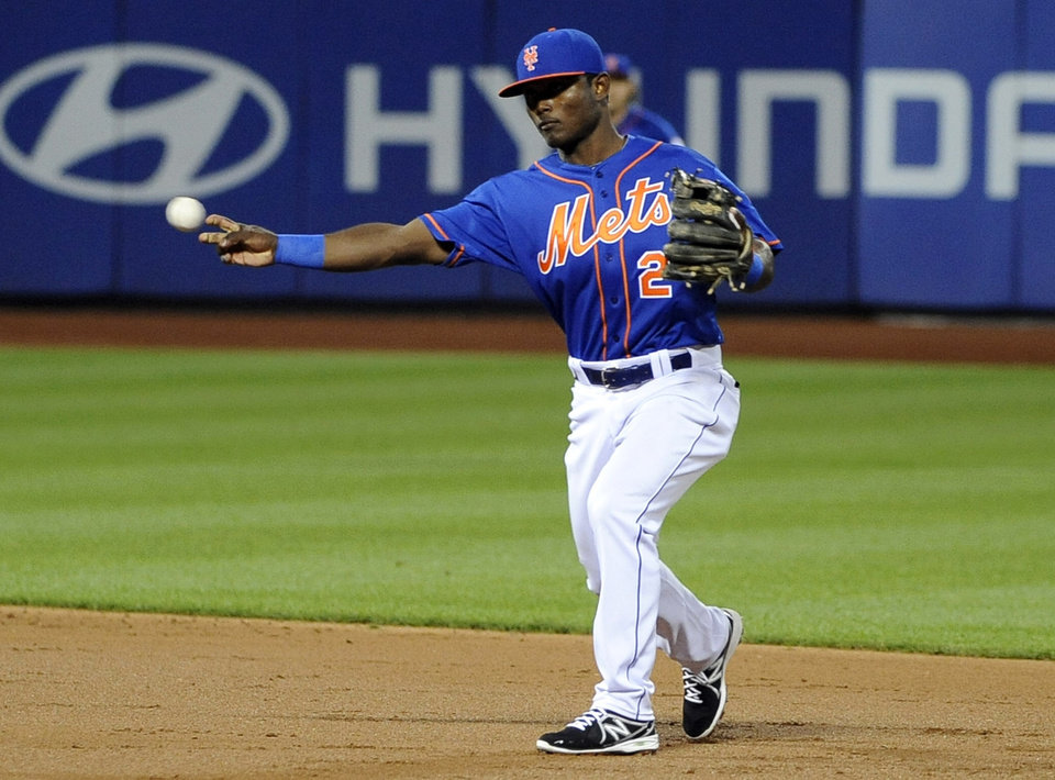 Photo - New York Mets second baseman Dilson Herrara throws out Philadelphia Phillies' Grady Sizemore in the second inning of a baseball game at Citi Field on Friday, Aug. 29, 2014, in New York. (AP Photo/Kathy Kmonicek)