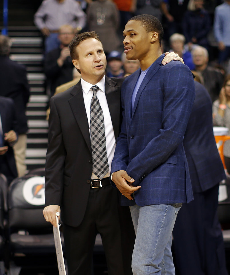 Oklahoma City coach Scot Brooks talks with Russell Westbrook before an NBA basketball game between the Oklahoma City Thunder and The Milwaukee Bucks at Chesapeake Energy Arena in Oklahoma City, Saturday, Jan. 11, 2014.  Oklahoma City won 101-85. Photo by Bryan Terry, The Oklahoman
