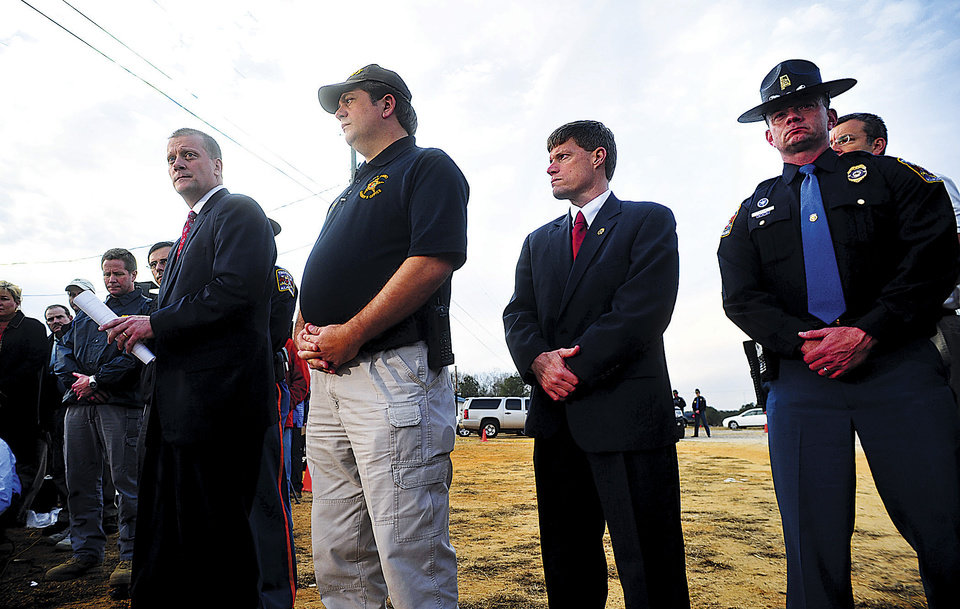 Photo - FBI Bureau Chief in Mobile, Steve Richardson, left, gives a statement to the media following the end of the hostage crisis in Midland City, Ala. on Monday afternoon, Feb. 4, 2013. Also pictured are Dale County Sheriff Wally Olsen, Dale County District Attorney Kirk Adams and State Trooper Kevin Cook. (AP Photo/The Dothan Eagle, Jay Hare)