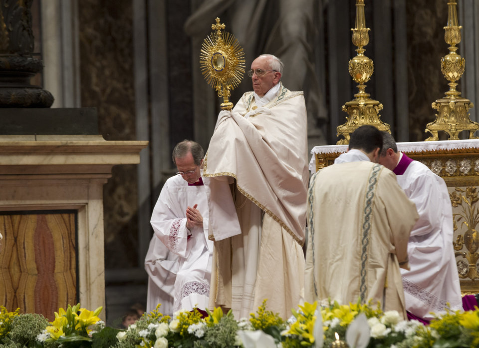 Photo - Pope Francis celebrates a worldwide Eucharistic adoration ceremony in St. Peter's Basilica, at the Vatican, Sunday, June 2, 2013. Pope Francis is appealing to the