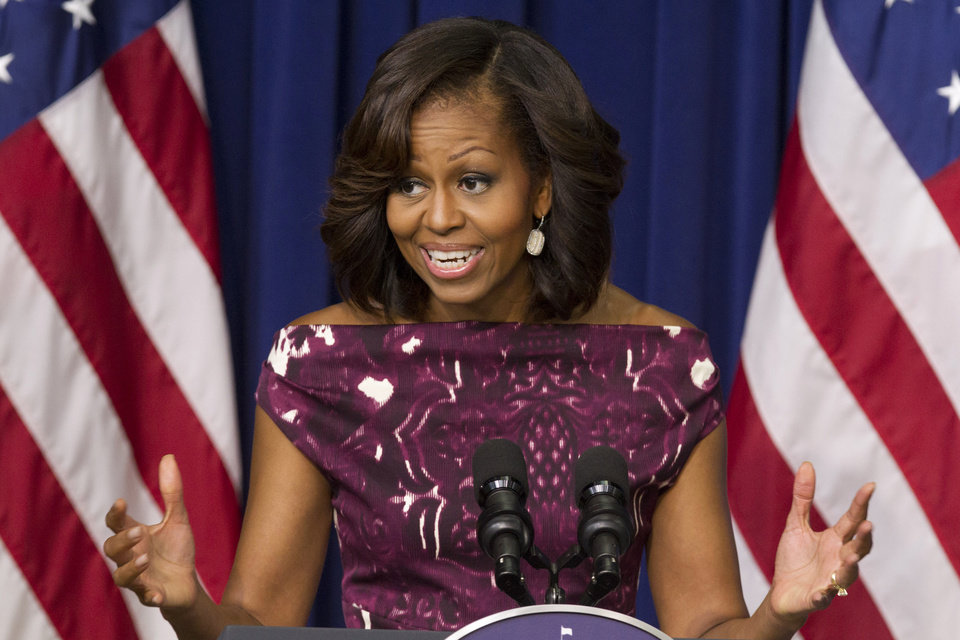 Photo - FILE - In this July 10, 2013, file photo, first lady Michelle Obama speaks to mayors and other officials about the initiative,