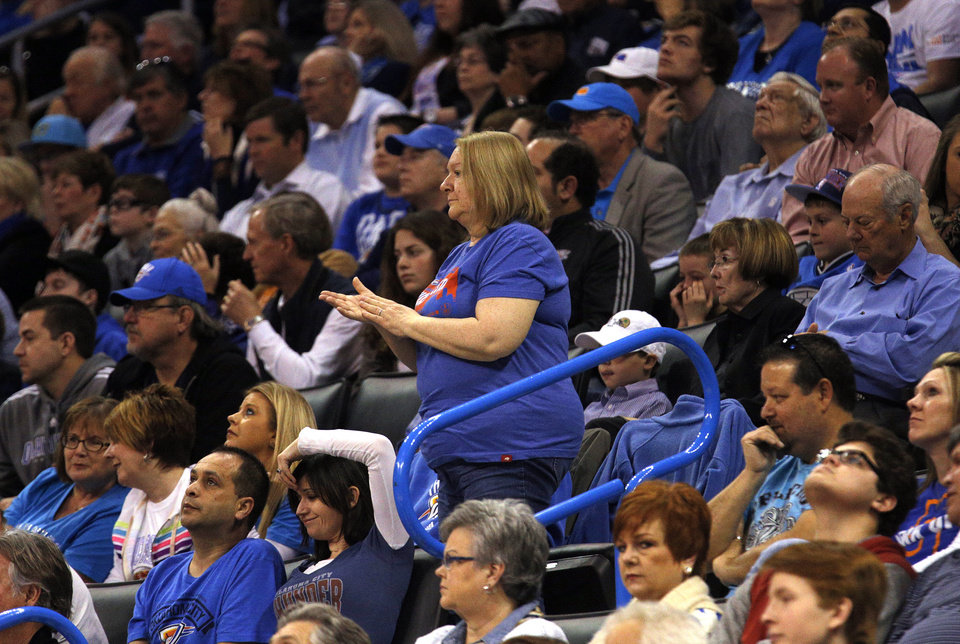 Photo - Susan Clark cheers for Oklahoma City 's Russell Westbrook (0) during the NBA game between the Oklahoma City Thunder and the Los  Angeles Clippers at the Chesapeake Energy Arena, Sunday, Feb. 23, 2014. Photo by Sarah Phipps, The Oklahoman