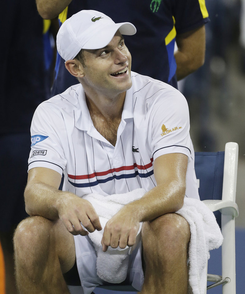 Photo -   Andy Roddick reacts as rain forces a delay in his match against Argentina's Juan Martin Del Potro in the quarterfinals of the 2012 US Open tennis tournament, Tuesday, Sept. 4, 2012, in New York. (AP Photo/Charles Krupa)