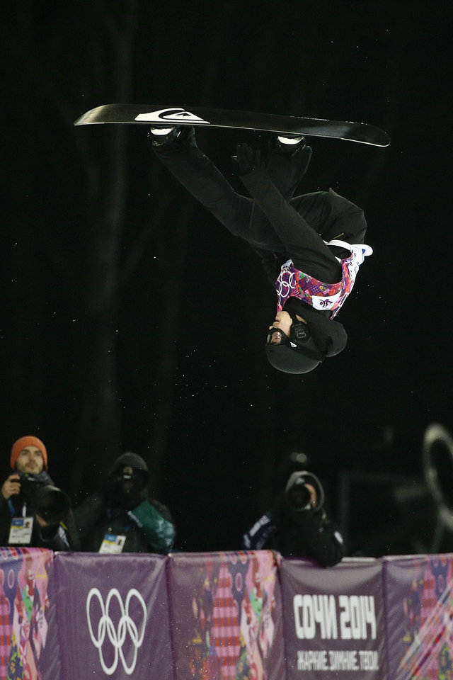 Photo - Switzerland's Iouri Podladtchikov competes in the men's snowboard halfpipe final at the Rosa Khutor Extreme Park, at the 2014 Winter Olympics, Tuesday, Feb. 11, 2014, in Krasnaya Polyana, Russia. Podladtchikov won the gold medal. (AP Photo/Jae C. Hong)