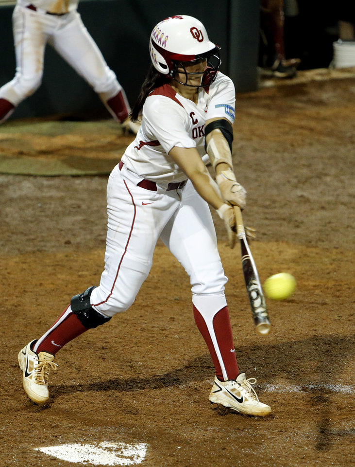 Photo - Oklahoma's Lauren Chamberlain hits a double in late innings as the University of Oklahoma Sooner (OU) softball team plays Tennessee in the first game of the NCAA super regional at Marita Hynes Field on May 23, 2014 in Norman, Okla. Photo by Steve Sisney, The Oklahoman
