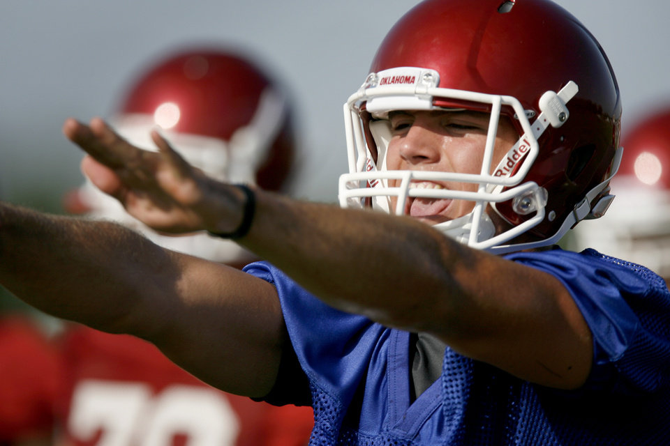 Photo - Oklahoma quarterback Blake Bell goes through a drill during OU's football practice in Norman, Okla. Friday, August 6, 2010.  Photo by Bryan Terry, The Oklahoman