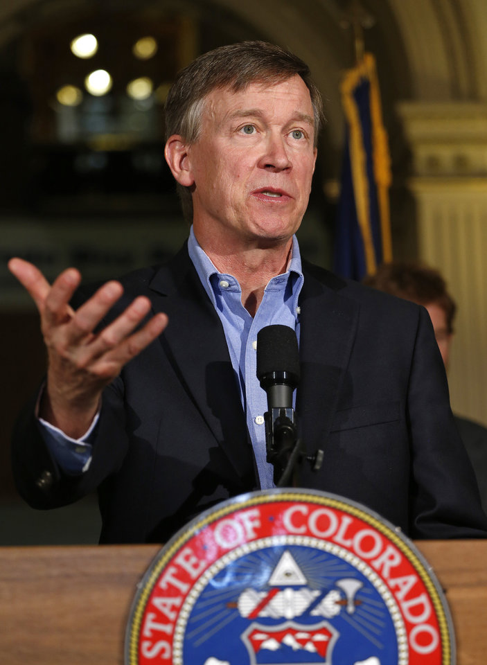 Photo - Colorado Gov. John Hickenlooper speaks during a news conference about fracking at the Capitol in Denver, Monday, Aug. 4, 2014. During the news conference Hickenlooper announced the creation of a task force charged with crafting recommendations to help minimize land use conflicts that can occur when siting oil and gas facilities near homes, schools, businesses and recreational areas. (AP Photo/Brennan Linsley)