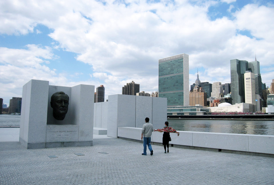 Photo - This May 1, 2014 photo shows visitors taking pictures in front of a bust of President Franklin D. Roosevelt at Franklin D. Roosevelt Four Freedoms Park, located on Roosevelt Island in New York City. The park, designed by renowned architect Louis I. Kahn, is considered an architectural masterpiece and offers scenic views of the city, including the Manhattan skyline. (AP Photo/Beth J. Harpaz)