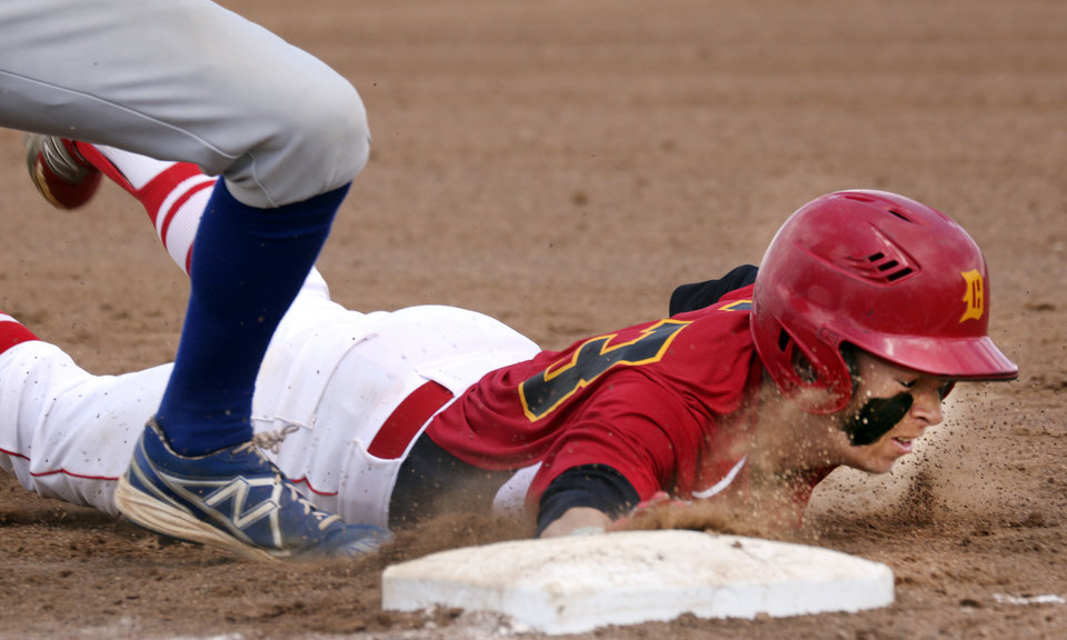 Photo - Dale's Tanner Nelson tags up on first base during their class 2A game with Ketchum at  Shawnee High School, Thursday May 15, 2014. Photo By Steve Gooch, The Oklahoman