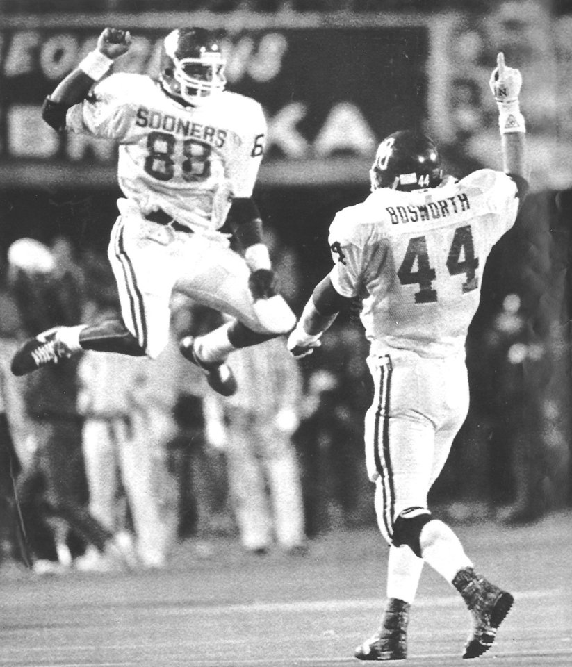 Former Sooners Keith Jackson and Brian Bosworth celebrate a come-from-behind, 20-17, win against Nebraska in Lincoln on Nov. 22, 1986. The Sooners scored 10 points in the last 82 seconds of the game to pull it out. PHOTO BY JIM ARGO, The Oklahoman Archives