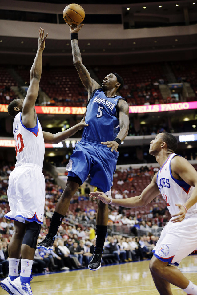 Minnesota Timberwolves' Josh Howard (5) shoots between Philadelphia 76ers' Lavoy Allen, left, and Evan Turner in the first half of an NBA basketball game, Tuesday, Dec. 4, 2012, in Philadelphia. (AP Photo/Matt Slocum)
