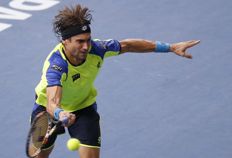 Photo - David Ferrer of Spain returns the ball to Novak Djokovic of Serbia during their final match, at the Paris Masters tennis at Bercy Arena in Paris, France, Sunday, Nov. 3, 2013. (AP Photo/Francois Mori)