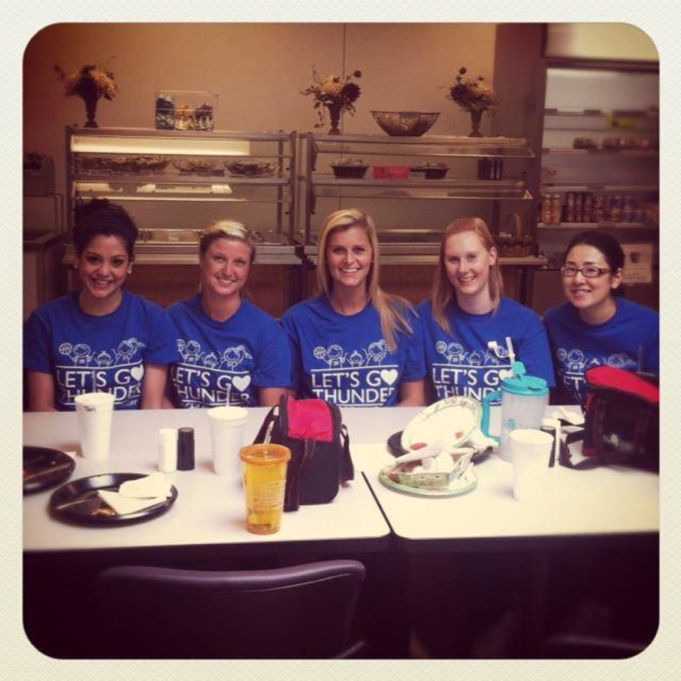Photo - The administration of The Children's Center in Bethany created Thunder shirts for its employees, including (from left) Tifani Lennert, Brooke Roulet, Ashley Beckley, Danielle Pearson and Saki Skramstad. PHOTO PROVIDED