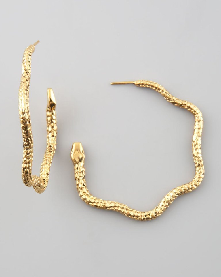 Photo - For those who follow the Chinese zodiac, the year of the snake begins Feb. 10. Some ways to incorporate the symbol of the year into your wardrobe, with no harm done to any living creature include these Aurelie Bidermann snake hoop earrings, $335 from NeimanMarcus.com. (NeimanMarcus.com via Los Angeles Times/MCT)