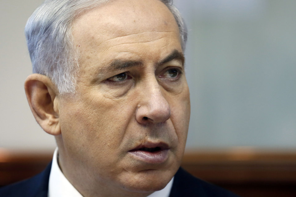 Photo - Israeli Prime Minister Benjamin Netanyahu chairs the weekly cabinet meeting in his office in Jerusalem, Sunday, July 6, 2014. Prime Minister Benjamin Netanyahu on Sunday said Israel would act calmly and responsibly in the face of rising Israeli-Palestinian hostilities, just hours after Israel's military carried out airstrikes on 10 sites in the Gaza Strip. (AP Photo/Gali Tibbon, Pool)