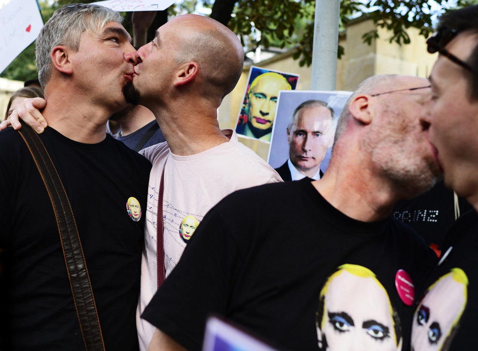 Photo - Demonstrators kiss near the Russian embassy in Prague, Sunday, Sept. 8, 2013. About a hundred gay rights supporters carried placards, wore special T-shirts and badges and chanted slogans outside the Russian embassy to protest Moscow's policies on homosexuality. (AP Photo/CTK, Roman Vondrous) SLOVAKIA OUT