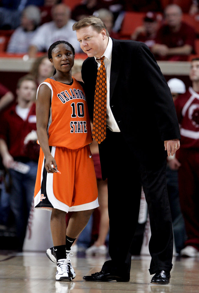 Photo - Head coach Kurt Budke talks to Andrea Riley late in the second half as the University of Oklahoma (OU) women's college basketball team defeats Oklahoma State University (OSU) 81-71 in the Lloyd Noble Center in Norman, Oklahoma on Saturday, February 23, 2008.   BY STEVE SISNEY, THE OKLAHOMAN
