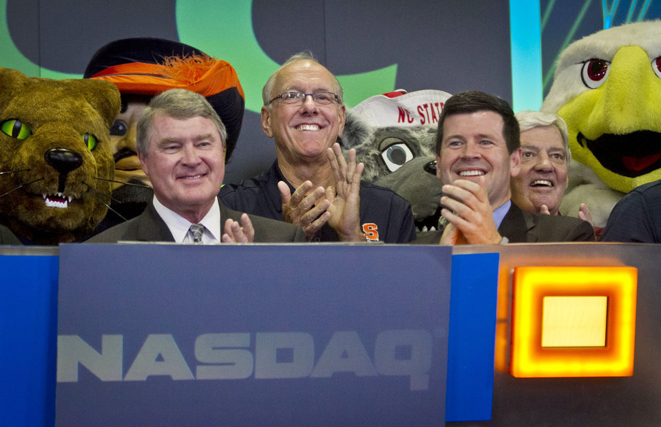 Photo - Atlantic Coast Conference  commissioner John Swofford, far left, Syracuse basketball coach Jim Boeheim, second from left, NASDAQ head of listings Bob McCooey, second from right, and  Virginia Tech football coach Frank Beamer, far right, reacts during the ringing of the closing bell on Monday, July 1, 2013 in New York.  The ACC visited the NASDAQ Market Site in Times Square to officially announce the addition of its three new members in Notre Dame, Pitt and Syracuse. (AP Photo/Bebeto Matthews)