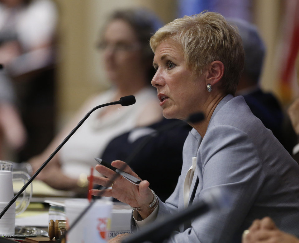Photo - Janet Barresi, state superintendent of Oklahoma schools, speaks Wednesday during a state Board of Education meeting in Oklahoma City. The board voted to delay adopting a formal plan to replace Common Core standards.  AP photo
