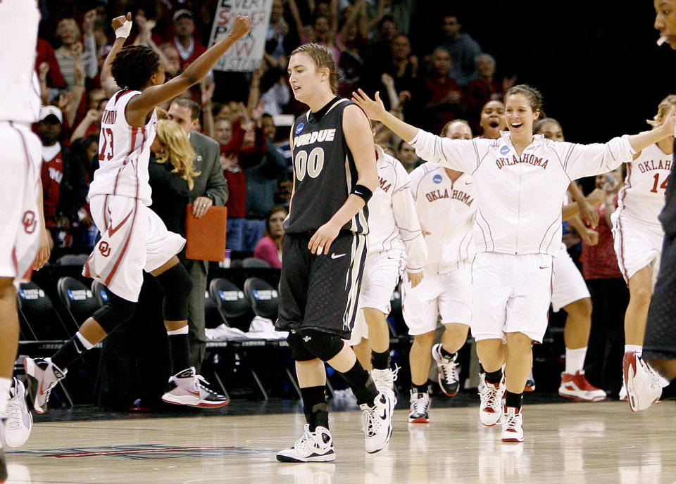 Photo - Purdue's Jodi Howell walks off the court after OU's win in the NCAA women's basketball regional  tournament finals between Oklahoma and Purdue at the Ford Center in Oklahoma City, Tuesday, March 31, 2009. OU won, 74-68. Photo by Bryan Terry, The Oklahoman