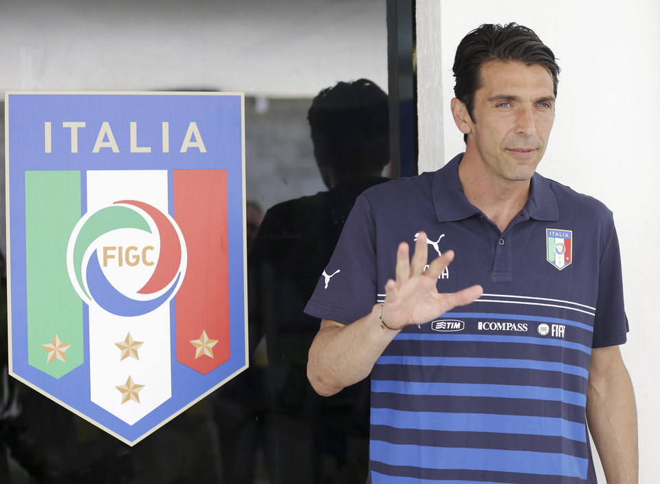 Photo - Italy goalkeeper Gianluigi Buffon arrives for a press conference at the Maria Lamas Farache Stadium in Natal, Brazil, Sunday, June 22, 2014. Italy play in group D of the 2014 soccer World Cup. (AP Photo/Antonio Calanni)