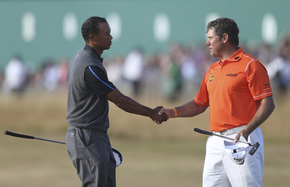 Tiger Woods of the United States, left, shakes hands with Lee Westwood of England on the 18th green after their third round of the British Open Golf Championship at Muirfield, Scotland, Saturday July 20, 2013. (AP Photo/Scott Heppell)