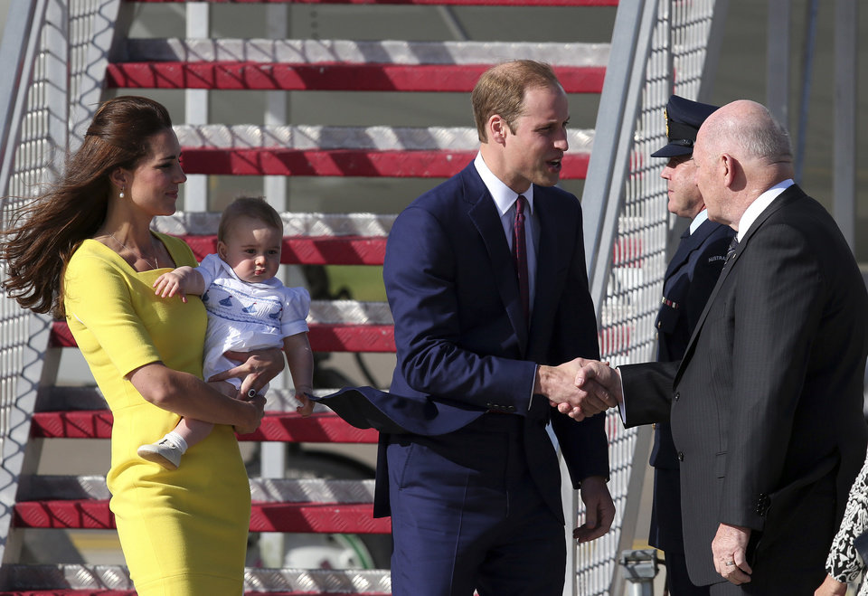 Britain's Prince William, center, his wife Kate, the Duchess of Cambridge  and their son Prince George are greeted by Australian Governor General Peter Cosgrove as they arrive in Sydney, Australia Wednesday, April 16, 2014. The royal family kicked off their tour of Australia. (AP Photo/Rob Griffith)