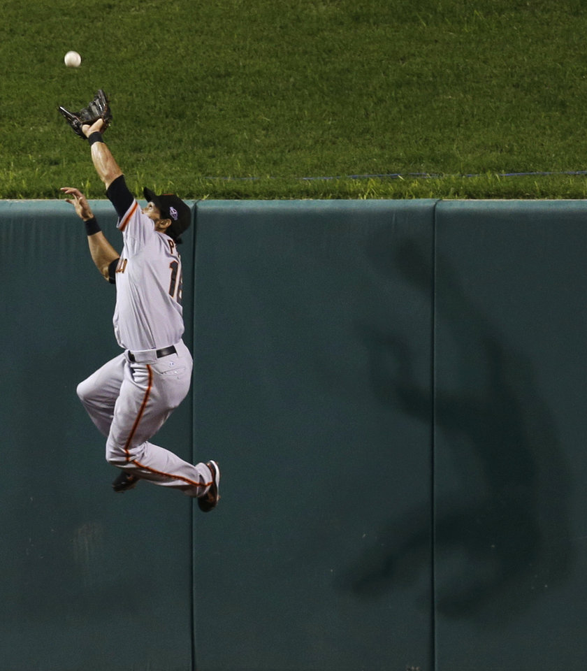 Photo -   San Francisco Giants' Angel Pagan goes up to catch a long fly ball hit by St. Louis Cardinals' Yadier Molina during the third inning of Game 4 of baseball's National League championship series Thursday, Oct. 18, 2012, in St. Louis. (AP Photo/David J. Phillip)