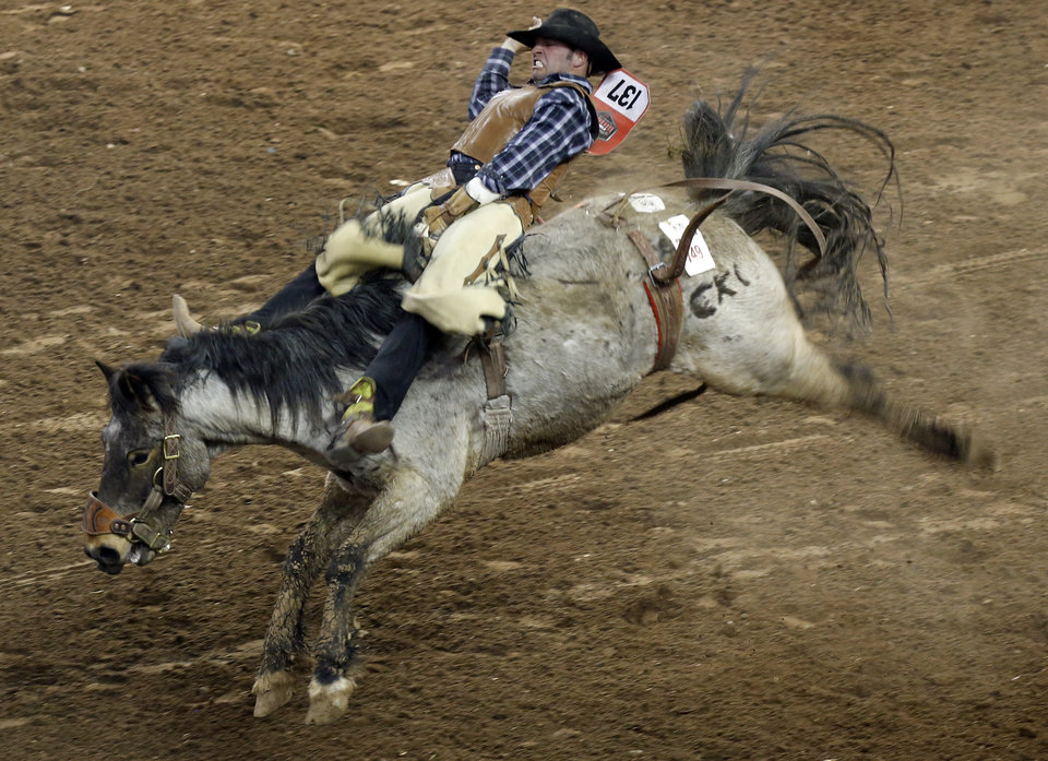 Jet Price rides in the bareback riding competition the National Circuit Finals Rodeo at the State Fair Arena in Oklahoma City, Friday, April 5, 2013. Photo by Sarah Phipps, The Oklahoman