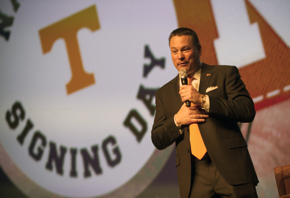 Photo - Tennessee head coach Butch Jones speaks during the university's NCAA college football recruiting celebration in Knoxville, Tenn., Wednesday, Feb. 5, 2014. (AP Photo/Knoxville News Sentinel, Adam Lau)