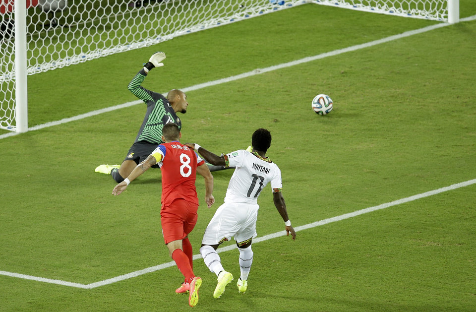Photo - United States' Clint Dempsey, center, scores the opening goal past during the group G World Cup soccer match between Ghana and the United States at the Arena das Dunas in Natal, Brazil, Monday, June 16, 2014. (AP Photo/Hassan Ammar)