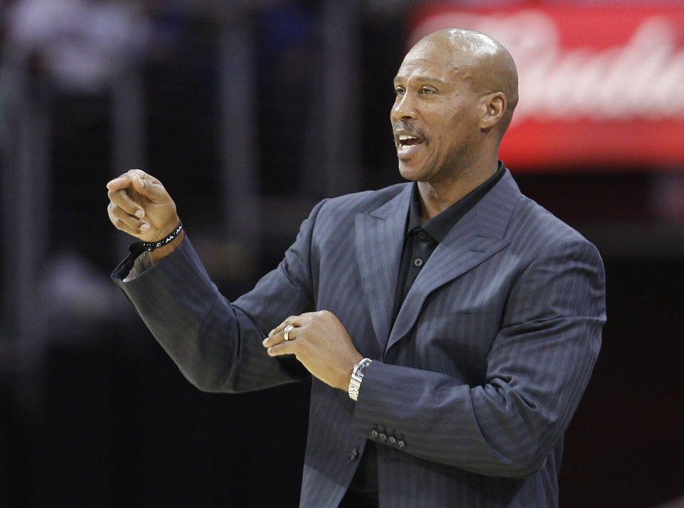 Photo -   Cleveland Cavaliers coach Byron Scott gestures during the second quarter of the Cavaliers' NBA preseason basketball game against the Indiana Pacers on Tuesday, Oct. 23, 2012, in Cleveland. The Pacers won 100-82. (AP Photo/Tony Dejak)