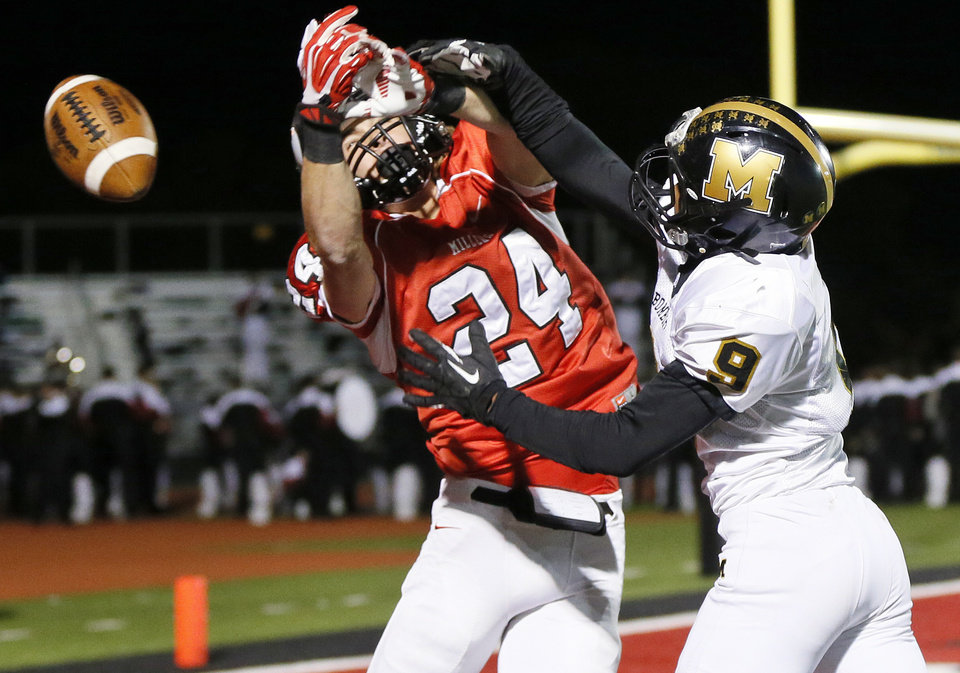 Photo -                    Midwest City's Demeco Wright, right, breaks up a pass intended for Yukon's Caelan Groce during a 2013 game. Wright is one of several returning defensive standouts for the Bombers.                                                                                            Photo by Nate Billings, The Oklahoman Archives
