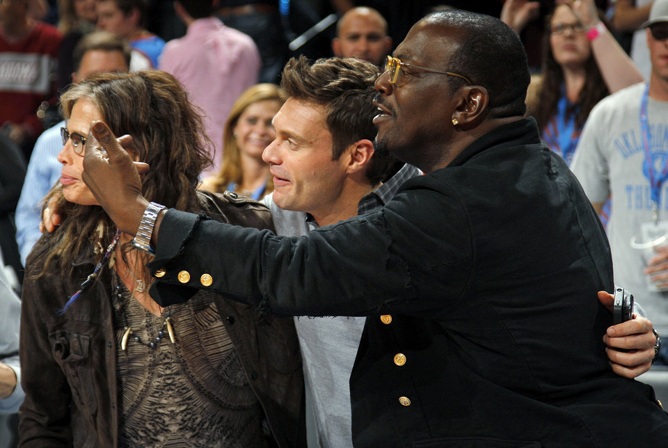 Photo - Randy Jackson, right, Ryan Seacrest, middle, and Steven Tyler gather together after an NBA basketball game between the Detroit Pistons and the Oklahoma City Thunder at the Chesapeake Energy Arena in Oklahoma City, Friday, Nov. 9, 2012. Oklahoma City won, 105-94. Photo by Nate Billings, The Oklahoman