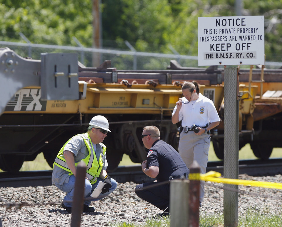 University of Oklahoma, BNSF officials and Norman police investigate the scene of a fatality accident where a pedestrian was struck by a train on Brooks St. near Classes Blvd on Saturday, May 14, 2011, in Norman, Okla.  Photo by Steve Sisney, The Oklahoman