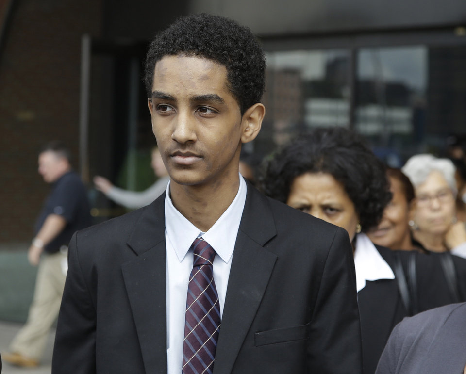 Robel Phillipos leaves federal court Friday, Sept. 13, 2013, in Boston after he was arraigned on charges of hindering the investigation of Boston Marathon bombing suspect Dzhokhar Tsarnaev. Phillipos pleaded not guilty to the charges.  (AP Photo/Stephan Savoia)