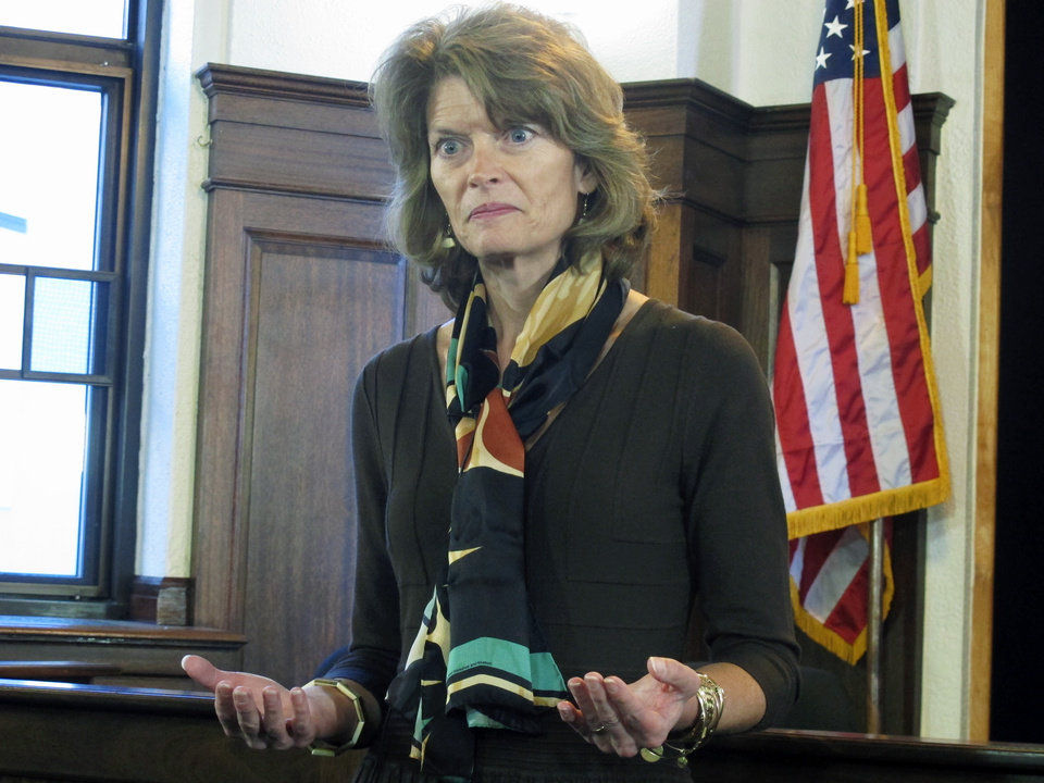 Photo - U.S. Sen. Lisa Murkowski addresses reporters during a news conference following her speech to a joint session of the Alaska Legislature on Wednesday, Feb. 19, 2014, in Juneau, Alaska. (AP Photo/Becky Bohrer)