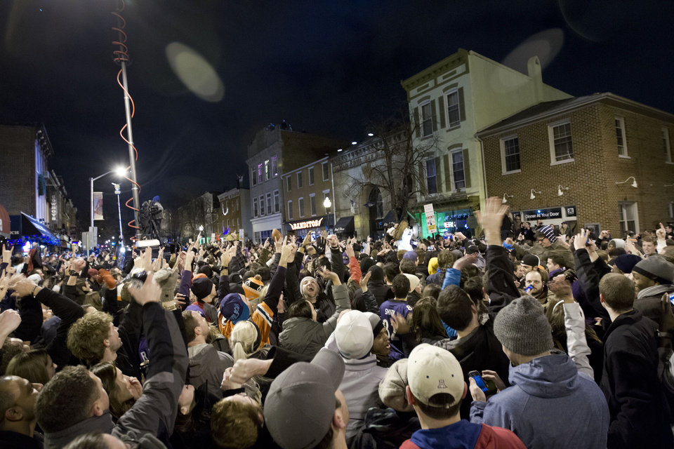 Photo - Baltimore Ravens fans celebrate in the streets in downtown Baltimore after their team won the Super Bowl in an NFL football game against the San Francisco 49ers, Sunday, Feb. 3, 2013. (AP Photo/Jose Luis Magana)