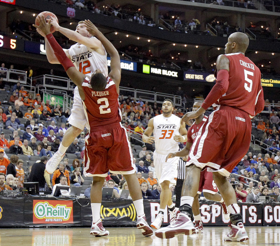Photo - OSU's Keiton Page is fouled by Steven Pledger in the first half of the college basketball game during the men's Big 12 Championship tournament at the Sprint Center on Wednesday, March 10, 2010, in Kansas City, Mo. Photo by Bryan Terry, The Oklahoman