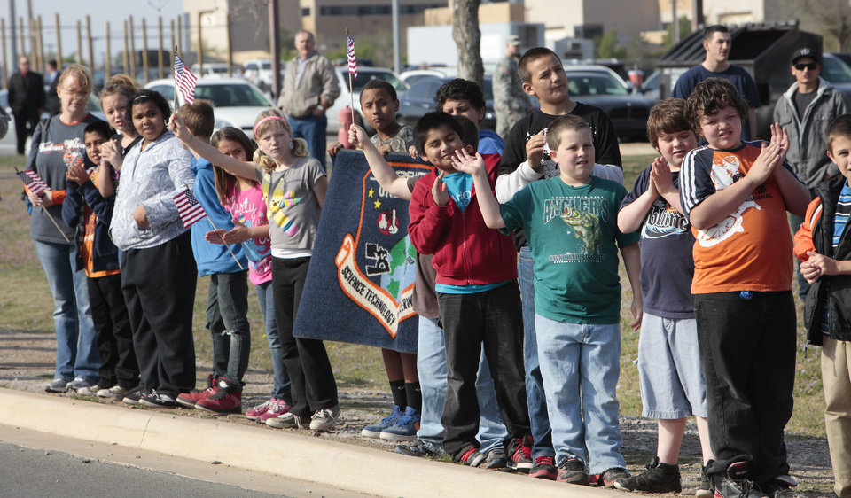 Woodrow Wilson Elementary School students wave flags Friday, March 29, 2013, to welcome home Vietnam veterans who did not get a welcome home at the end of the war. Photo By David McDaniel, The Oklahoman <strong>David McDaniel - The Oklahoman</strong>