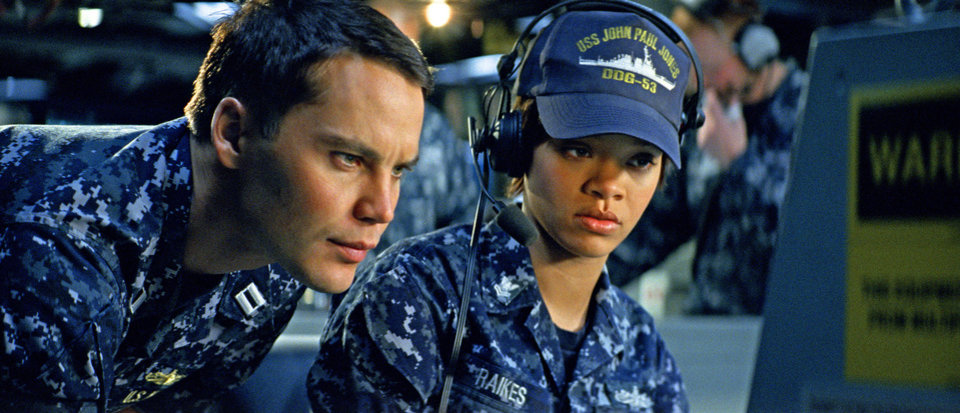 Photo - In this film image provided by Universal Pictures, Taylor Kitsch, left, and Rihanna are shown in a scene from
