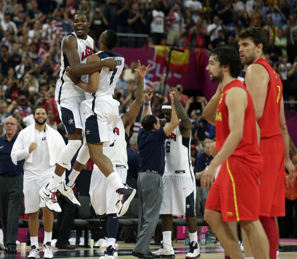 United States\' Kevin Durant and Russell Westbrook celebrate after the men\'s gold medal basketball game against Spain at the 2012 Summer Olympics, Sunday, Aug. 12, 2012, in London. USA won 107-100. AP photo