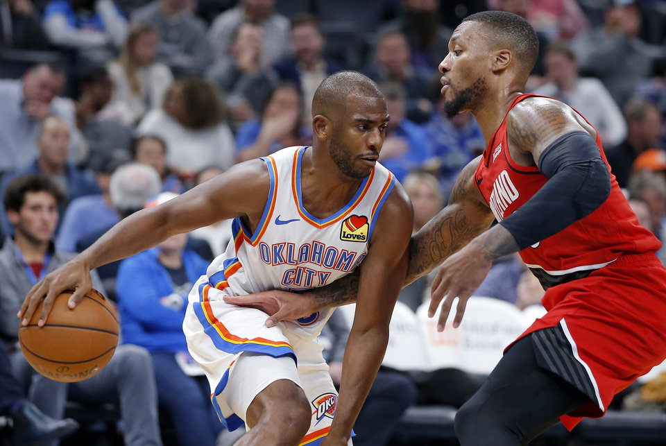Photo -  Oklahoma City's Chris Paul, left, tries to get past Portland's Damian Lillard during Wednesday night's game at Chesapeake Energy Arena. The Thunder lost, 102-99. [Bryan Terry/The Oklahoman]