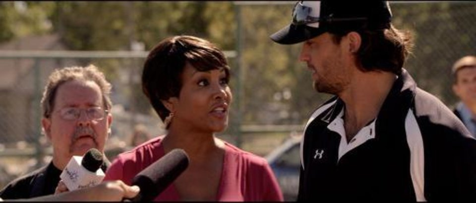 "From left, Vivica A. Fox and Scott Elrod appear in a scene from the faith-based baseball drama ""Home Run,"" which was filmed in Okmulgee and Tulsa."