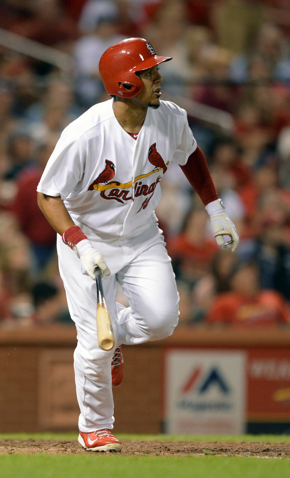 Photo - St. Louis Cardinals' Jon Jay watches his two-run double against the San Diego Padres in the eighth inning in a baseball game, Thursday, Aug. 14, 2014, at Busch Stadium in St. Louis. (AP Photo/Bill Boyce)